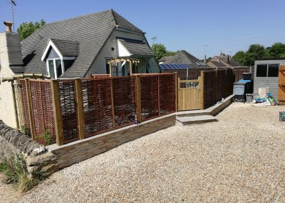 A front garden area re-built and formed to meet the clients spec, enclosed with willow panels for privacy.