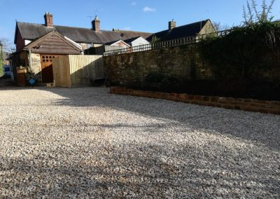 A revamped shingle driveway using stabilising grids within