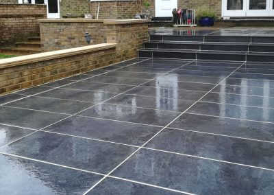 A dark porcelain slab used for a new terraced patio area.