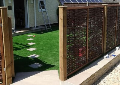 Willow panels enclosing a front garden area that was completely revamped.