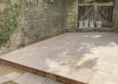 A revamped courtyard using Indian sandstone for some fresh paving within the area.