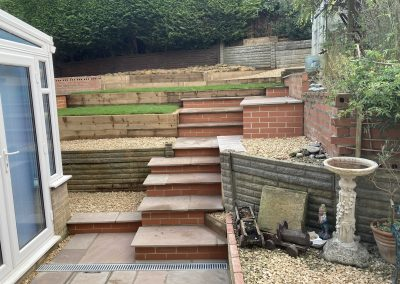A newly formed section of steps built in brick and Indian sandstone, to allow for safer acces up and into the tiered garden.